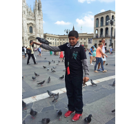 Abdul Rahman waited a long time to feel the touch of bird, but he was afraid when it touched his hand with its small feet - Milan - Italy  (28th July 2015)